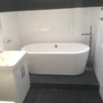 installation of a new white bathroom suite