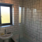 tiled bathroom with new bathroom furniture